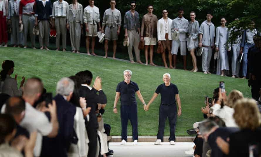 Giorgio Armani, right, and longtime collaborator Leo Dell'Orco acknowledge the applause of the audience.