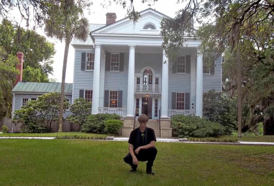 A photo shows Dylann Roof posing at McLeod Plantation in Charleston, SC. Roof later murdered nine African American members of the Emanuel AME Church in 2015.