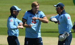 England's David Willey (centre) celebrates with Eoin Morgan and Jonny Bairstow after claiming another Irish wicket.