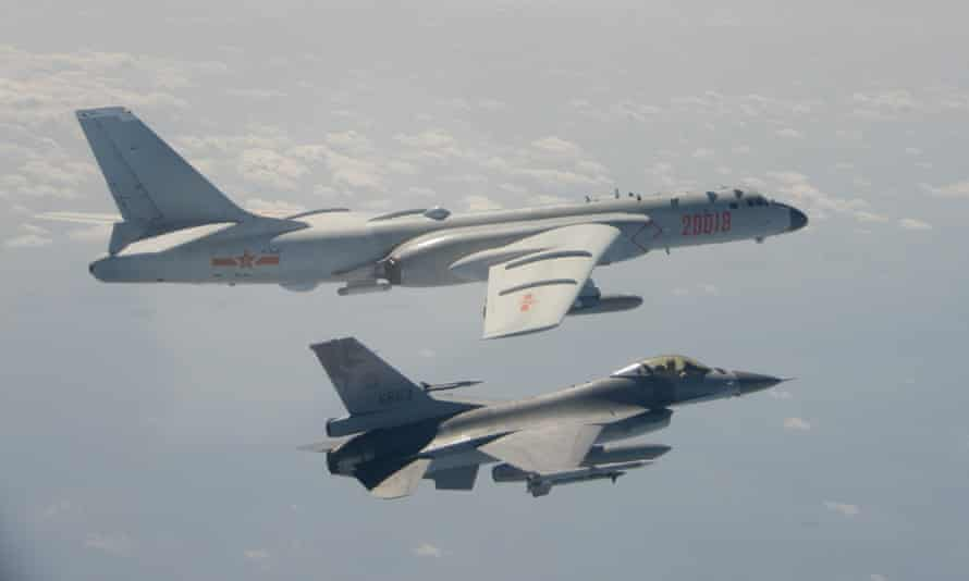 A Taiwanese F-16 fighter jet flies next to a Chinese H-6 bomber in Taiwan's airspace in February.