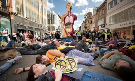Extinction Rebellion protesters stage a 'die in' in Leeds.
