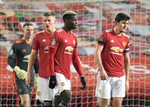 Manchester United's Paul Pogba and Harry Maguire look dejected after Manchester City's John Stones scored their first goal.