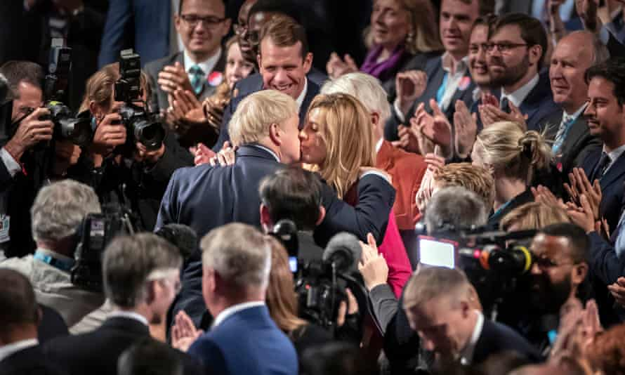 Boris Johnson and Carrie Symonds kiss at the Tory party conference, his first as prime minister.