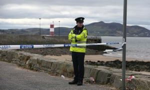 A policeman at the scene at Buncrana Pier in Co Donegal.