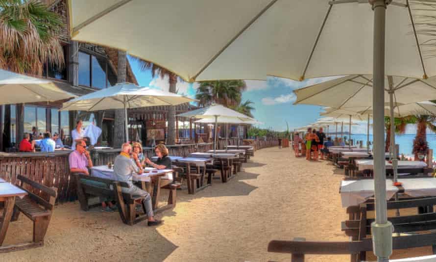 Sajorami Beach, Zahora, Cadiz a few people drinking at tables.