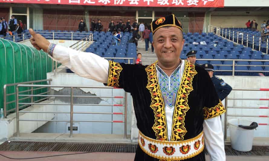 A Uighur fan leader at the stadium in Urumqi.