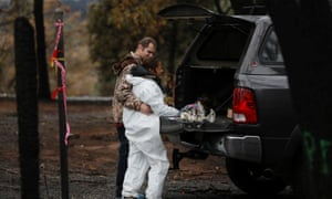 Brett Bizzle comforts his wife, Vanthy, who became emotional after returning to the remains of their home for the first time since the Camp fire forced them to evacuate Paradise.