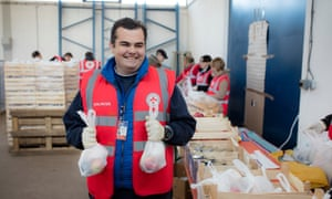 Bruno Grgurević, one of the Red Cross volunteers arranging for food packs to be distributed to arriving refugees at the Slavonski Brod temporary transit centre.