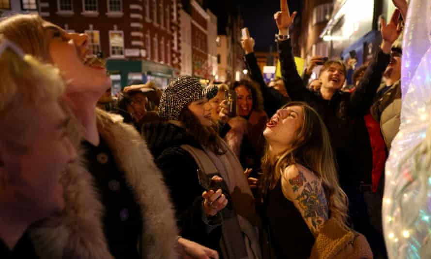People partying in Soho in December
