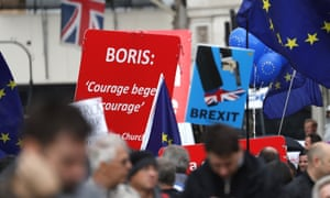 Pro and anti-Brexit supporters hold signs and flags while demonstrating outside the Parliament in London, Wednesday, Sept. 25, 2019.