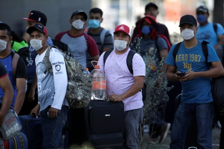 Migrants seeking a U.S. work visa are pictured after being evicted from their hotel, which local authorities said was crowded, as part of the measures to prevent the spreading of the coronavirus disease in Monterrey, Mexico.