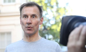 Jeremy Hunt speaking to reporters after his morning run in London on Thursday.