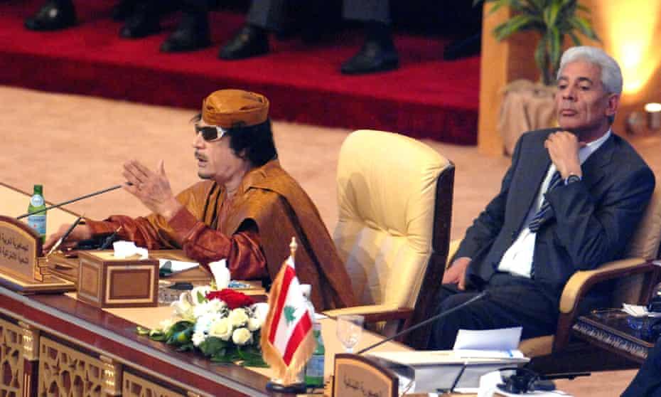 Muammar Gadaffi (left) with Moussa Koussa at the 21st Arab League leaders summit in Qatar in 2009.