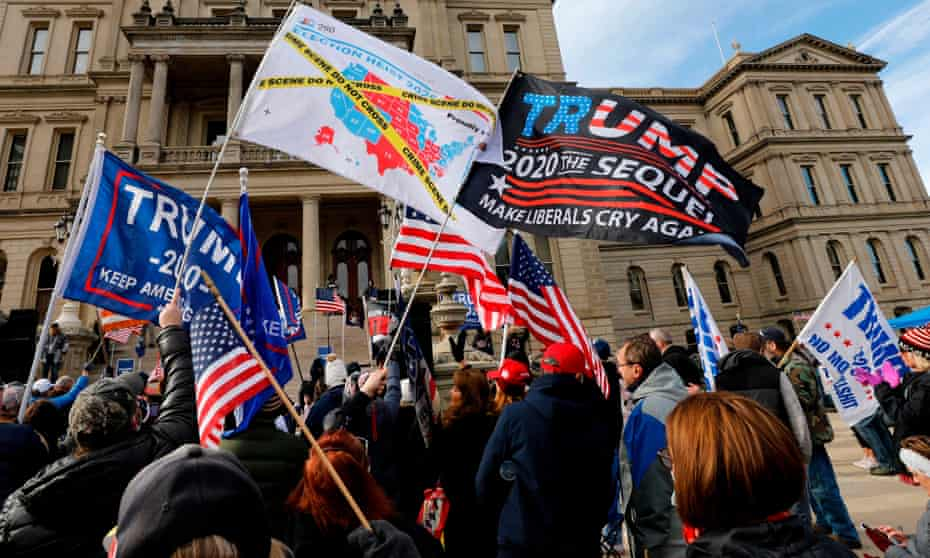 People gather at the Michigan state capitol for a 'Stop the Steal' rally in support of Donald Trump on 14 November 2020, in Lansing, Michigan.