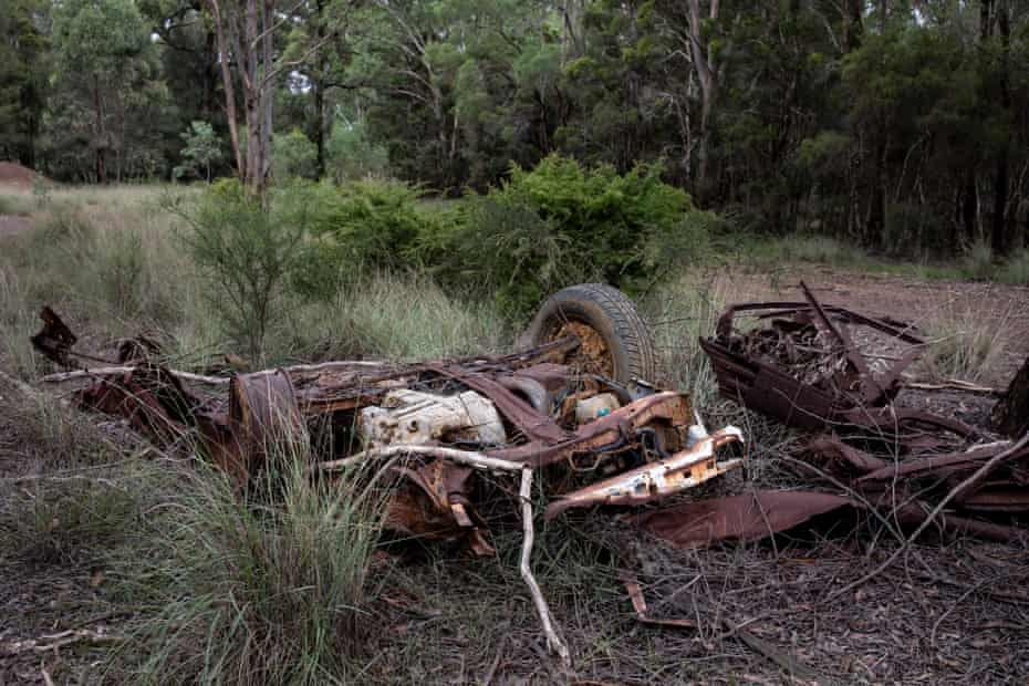 Colebee, NSW, Australia. A long abandoned vehicle in the Colebee Reserve. Colebee Reserve, in the suburb of Colebee near Marsden Park is surrounded on two sides by development that leads into vast estates.