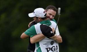 Jimmy Walker hugs his caddie, Andy Sanders, after his par putt to win the 2016 US PGA Championship.