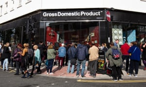 Members of the public gather outside Gross Domestic Product, a homeware store launched in south London by the artist Banksy