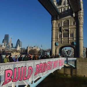 Demonstrators with a banner on Tower Bridge