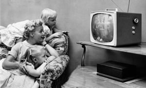 Family watching TV in 1955