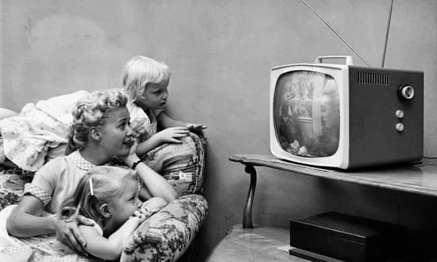 A family watching television in their home, circa 1955.