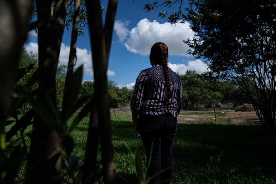 """Blanca, 36, outside of her home that she rents. She recently emigrated from Mexico and has had to get used to the fieldwork which she does not enjoy. Blanca says she is good at doing pedicures, but is not able to do that in the U.S. because she is undocumented. """"It's harder for women to work the fields. Some can, but I'm just not used to it."""""""