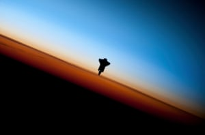 The space shuttle Endeavour is silhouetted against the backdrop of Earth's horizon prior to docking with the International Space Station in this picture taken by an Expedition 22 crew member on February 9, 2010 and released by NASA February 12, 2010. REUTERS/NASA Handout (UNITED STATES - Tags: SCI TECH IMAGES OF THE DAY) FOR EDITORIAL USE ONLY. NOT FOR SALE FOR MARKETING OR ADVERTISING CAMPAIGNS - GM1E62D1J0801