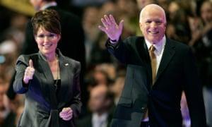 Senator John McCain and Alaska Governor Sarah Palin gesture onstage at the 2008 Republican National Convention in St Paul, Minnesota.