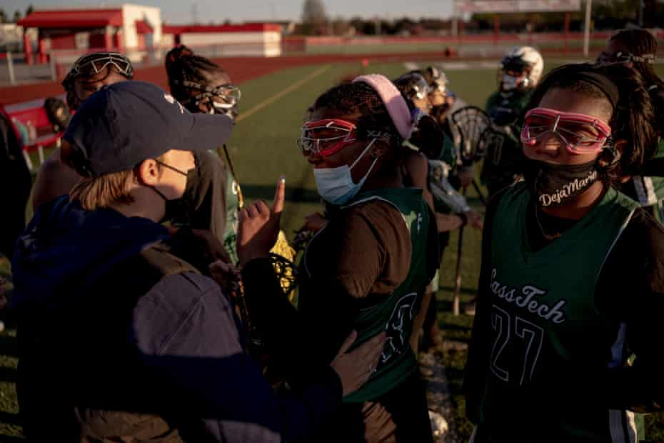 Senior captain, Alexia Carrol-Williams, 17, talks with Coach Summer Aldred after the first half during the game between Cass Tech and Chippewa Valley in Clinton Township, Michigan on April 30, 2021. Cass Tech took their second win of the season 14-6.