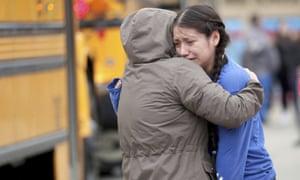 Gabriela Mauricio, right, a 14-year-old freshman, hugs her mother, Meche Mauricio, outside Waukesha South high school.