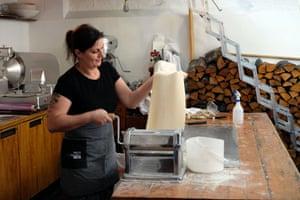 Preparing pasta dough for the tortelli.