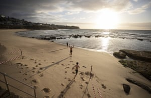 Swimmers run into the water as Bronte Beach in Sydney is reopened following Covid lockdown.