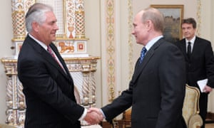 Vladimir Putin and Rex Tillerson shaking hands