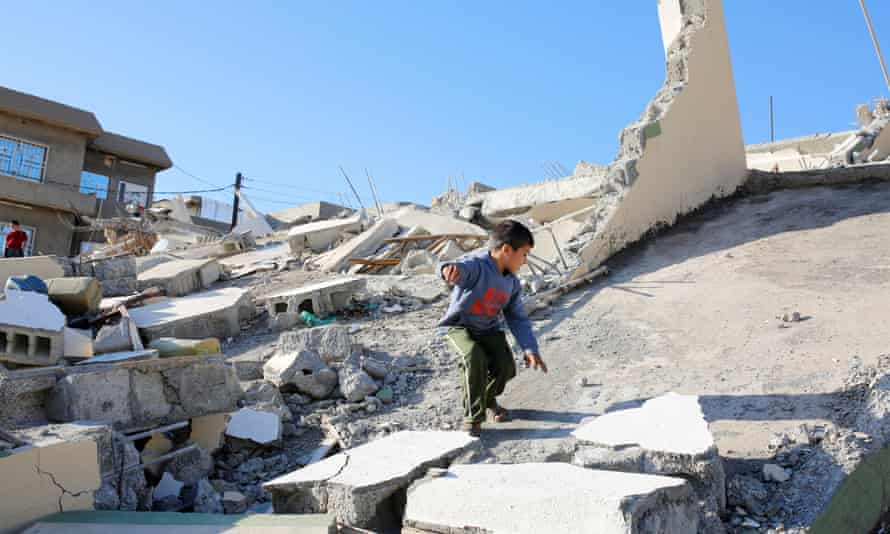 A child on a collapsed building at Darbandikhan, Sulaymaniyah, Iraq on Monday after northern Iraq and Iran were hit by a 7.3 magnitude earthquake.