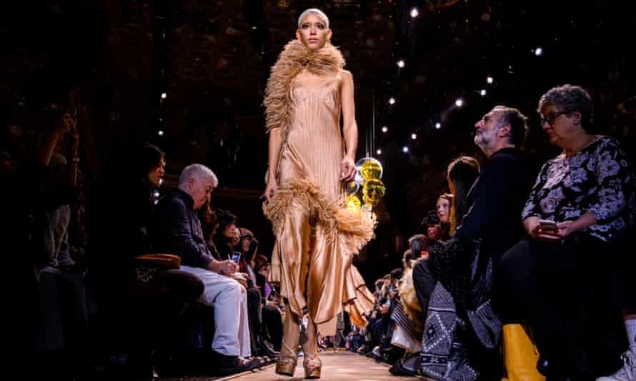 A world of glamour: a runway model wearing a Michael Kors gown at New York Fashion Week in February.