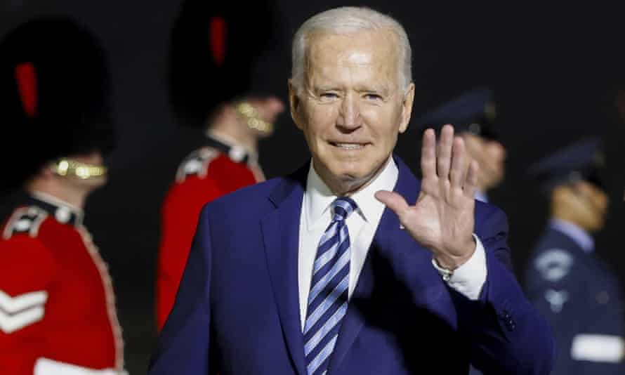 The US president, Joe Biden, waves on his arrival on Air Force One at Cornwall Airport Newquay, England.