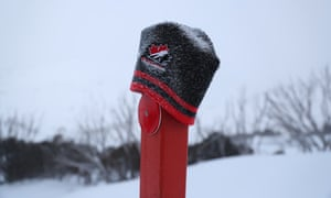 A lost beanie on a road-side marker at Guthega in NSW after days of blizzard in the Australian alps.