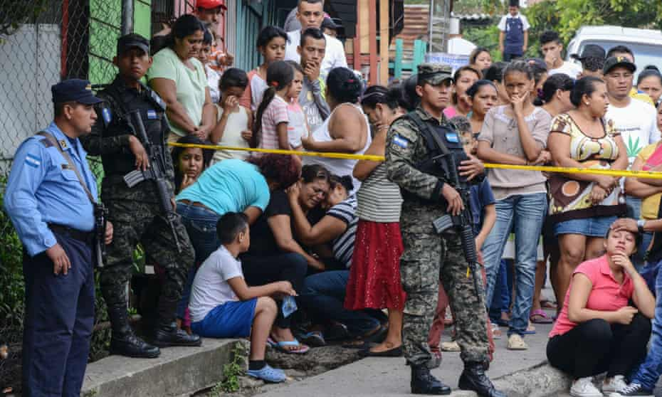 A woman and other relatives of a bus driver who was killed in Tegucigalpa, Honduras, by alleged gang members for refusing to pay them a 'war tax'.