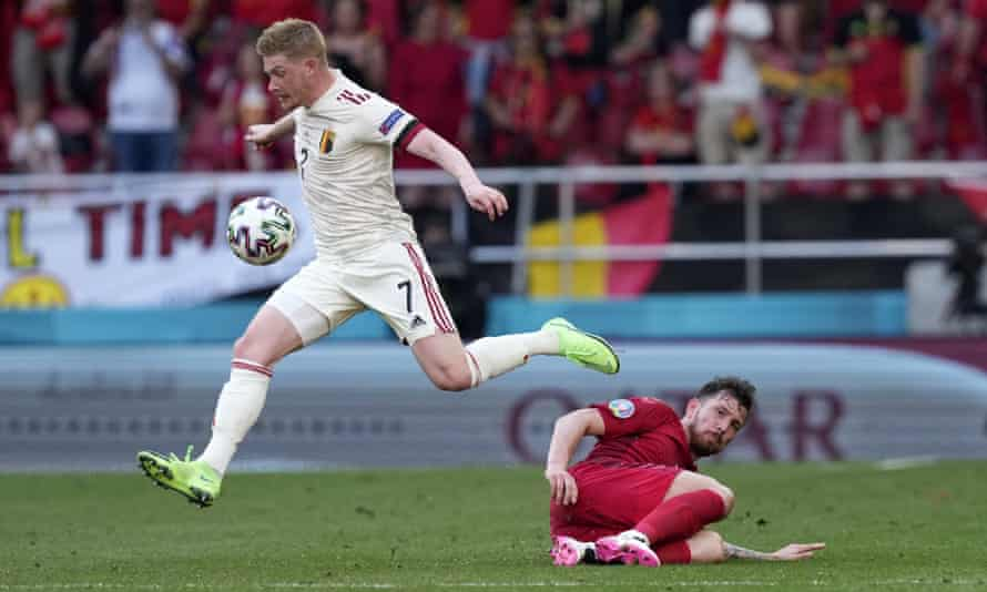 Kevin De Bruyne skips over a challenge from Denmark's Pierre-Emile Højbjerg during Belgium's second-half fightback.