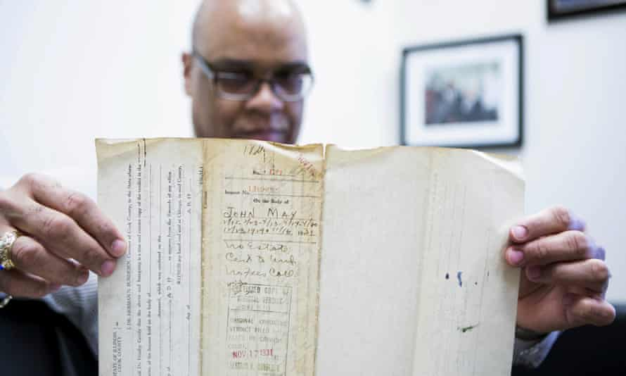James Sledge holds one of the original autopsy reports. 'It gives you an odd feeling,' he said.