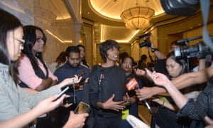 Malaysian LGBT rights activists talks to press outside court