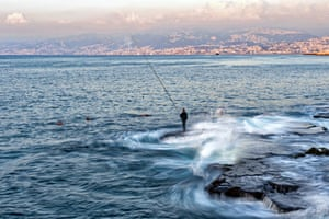 Beirut, LebanonA photograph taken with a low shutter speed shows a fishing man during a sunny day at the Corniche al-Manara