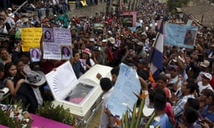 Friends and supporters gather near the coffin of slain environmental rights activist Berta Caceres as they attend a mass outside the Virgen de Lourdes church.