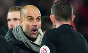 Pep Guardiola makes his feelings known to referee Michael Oliver.