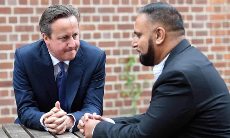 David Cameron speaks with Birmingham resident Abdullah Rehman