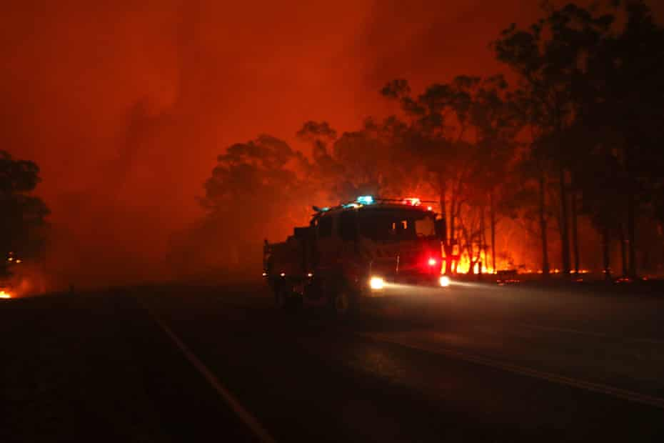 Flames rage near properties on the Sussex inlet road, south of Nowra.