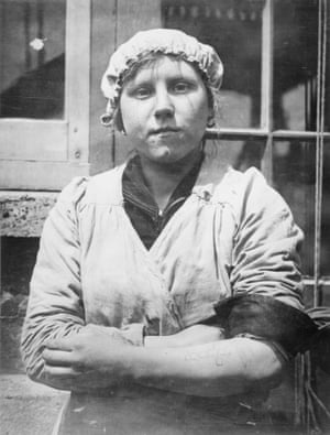 A munitions worker with a tattoo on her left arm bearing the name of a loved one who died at the front. The memorial cross was added later.