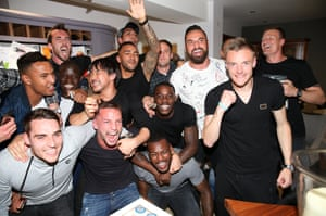 Jamie Vardy celebrates the title at his home with team-mates.