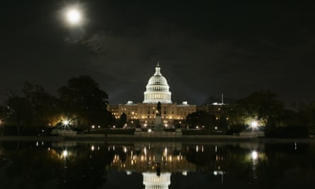 The U.S. Capitol building is illuminated by a full moon on the night before the U.S. mid-term congressional election in Washington<br>The U.S. Capitol building is mirrored in its reflecting pool on the night before the U.S. mid-term congressional elections in Washington November 6, 2006. Americans go to the polls on Tuesday to vote in an election that many experts have predicted may shift the balance of power in Congress from the Republicans to the Democrats. REUTERS/Jim Bourg (UNITED STATES)