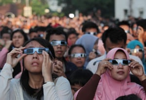 Millions of people across Indonesia experienced a total solar eclipse this week, with parts of the region falling into complete darkness as the moon moved directly between the Earth and the sun. People along a 150km-wide strip, running through Sumatra, Borneo and Sulawesi, Indonesia, experienced the total eclipse for up to about four minutes. These sky gazers were in Palembang city, South Sumatra province. The rare natural phenomenon was marked by parties, tribal rituals and Muslim prayers, and thousands of pairs of eclipse glasses were distributed.