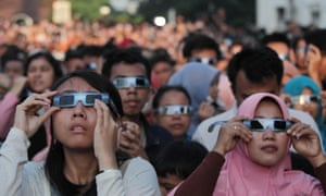 Always use eclipse glasses when looking at the sun, as these people did for the Indonesia eclipse of 2016.